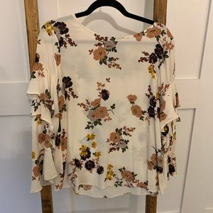 Long sleeved floral ruffle blouse